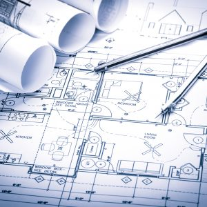 Architecture concept with  drawing compass on blueprints.